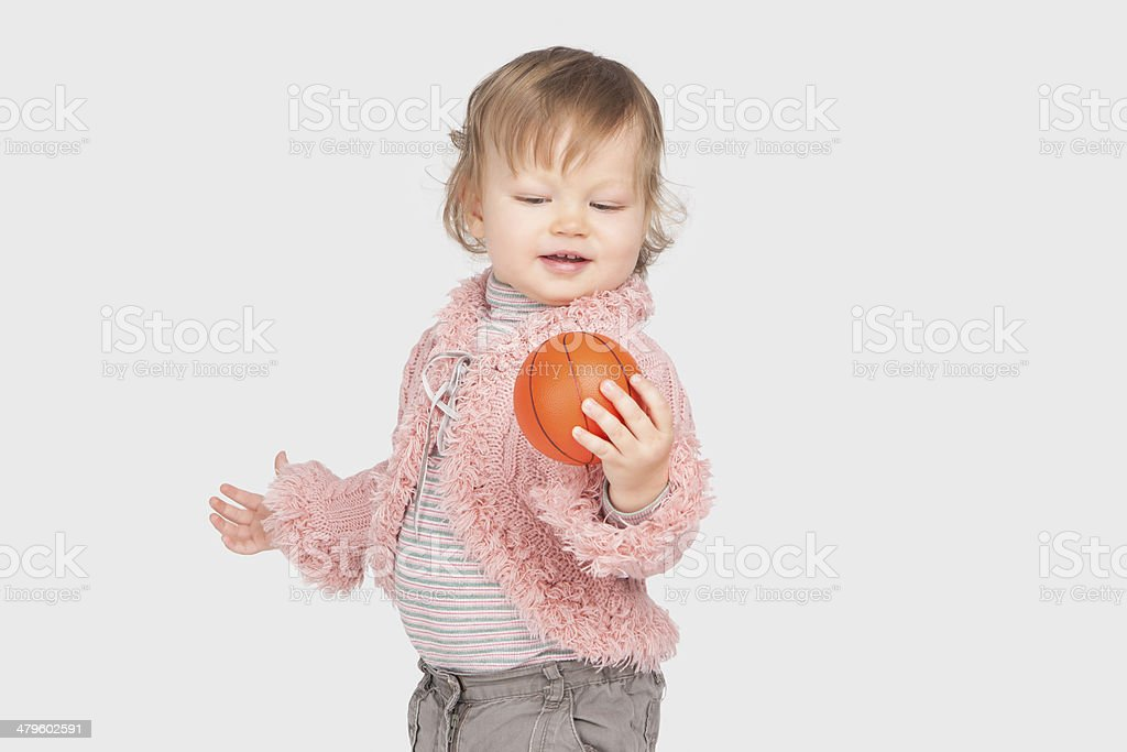 Little girl with small ball stock photo