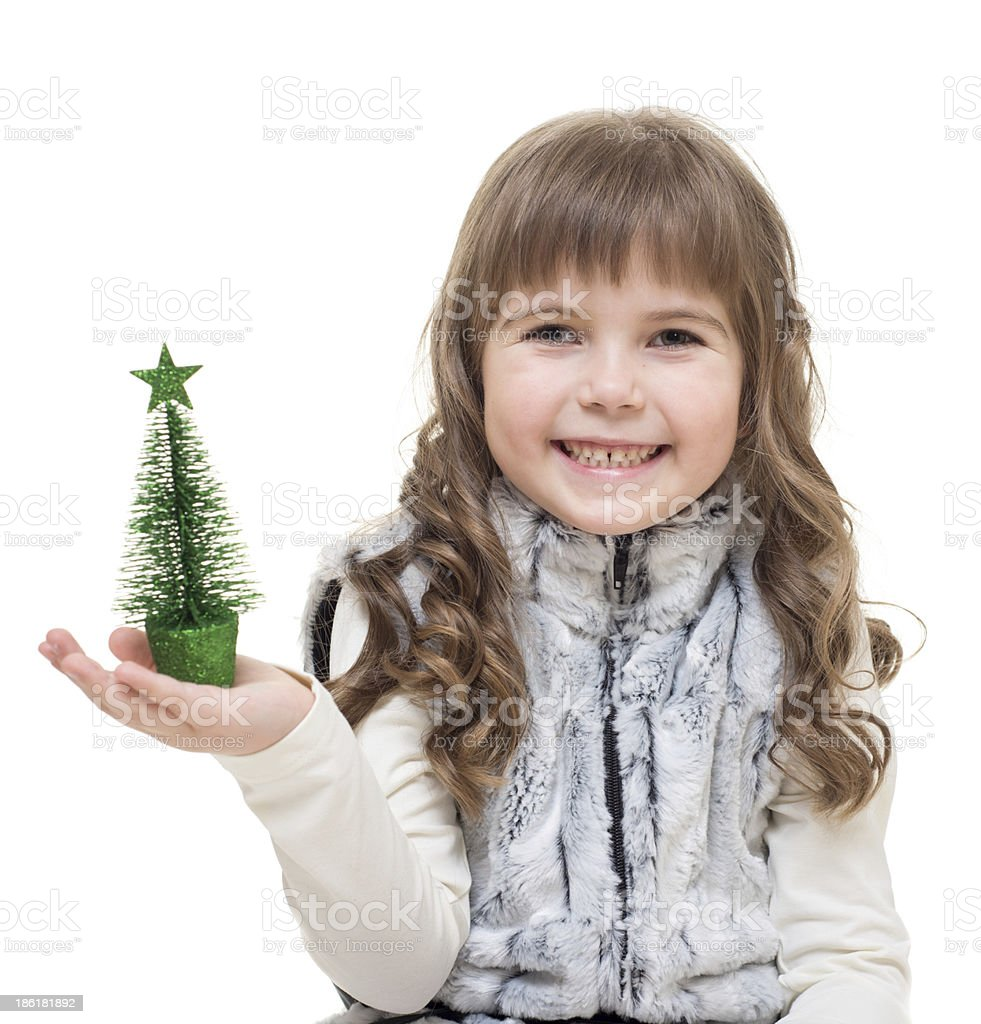 Little girl with small christmas tree  enjoy the holidays royalty-free stock photo