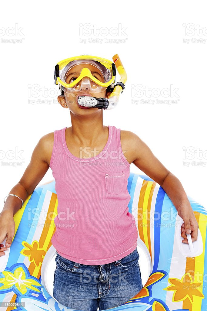 Little girl with snorkeling equipments looking upwards royalty-free stock photo