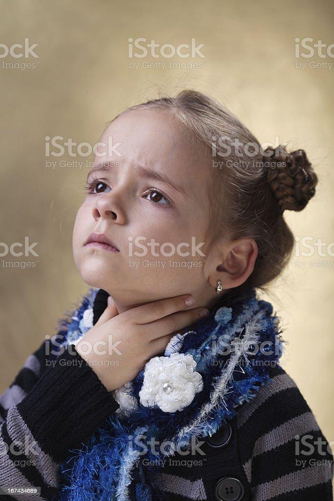 Little girl with sore throat in flu season stock photo