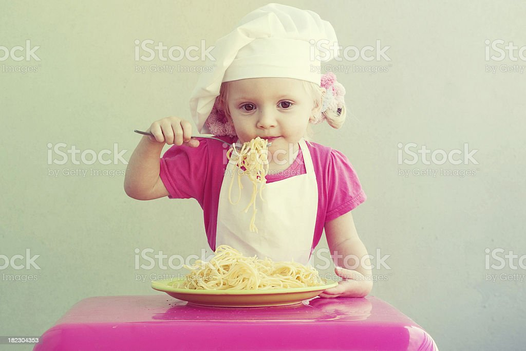 Little girl with spaghetti stock photo
