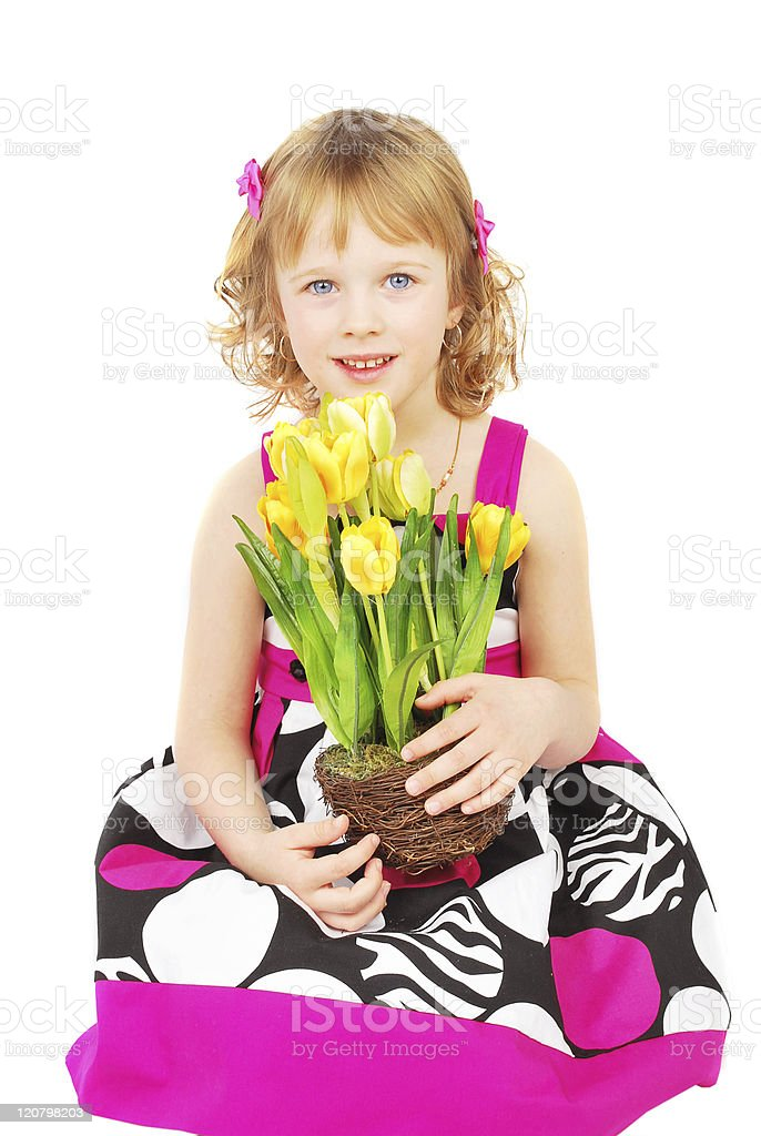 Little girl with spring flowers. royalty-free stock photo