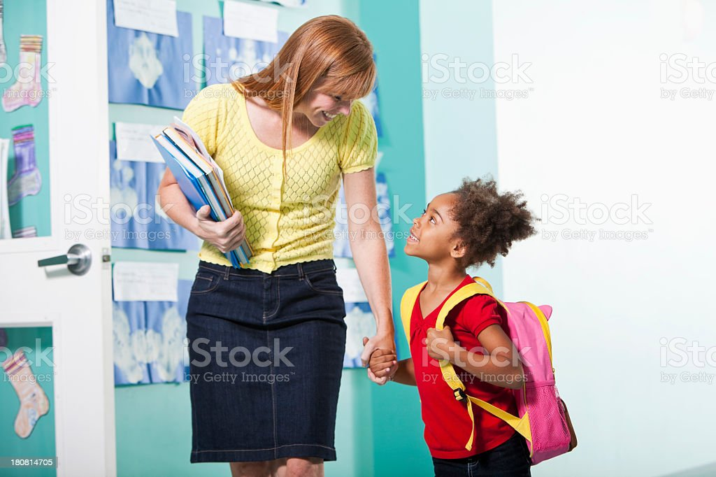 Little girl with teacher royalty-free stock photo