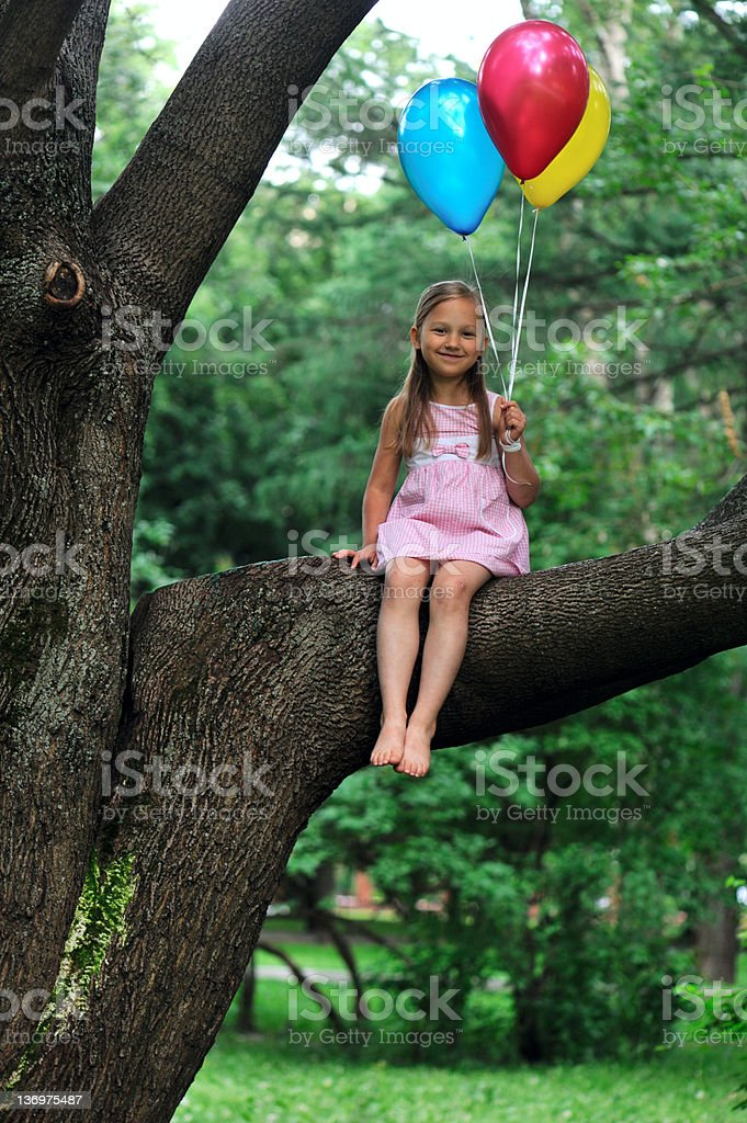 Little girl with three baloons royalty-free stock photo