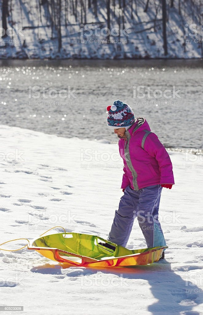Little girl with toboggan royalty-free stock photo