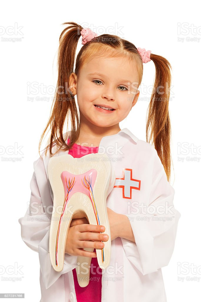 Little girl with tooth dummy playing dentist stock photo