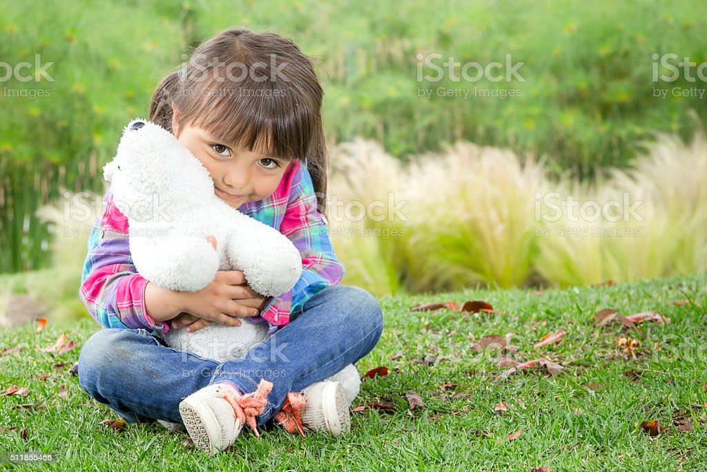Little girl with toy stock photo