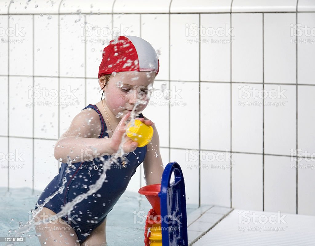 Little girl with toys at the swimming pool royalty-free stock photo