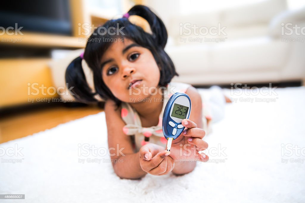 Little Girl with Type I Diabetes stock photo
