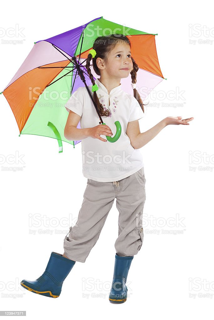 Little girl with umbrella, checking for rain royalty-free stock photo