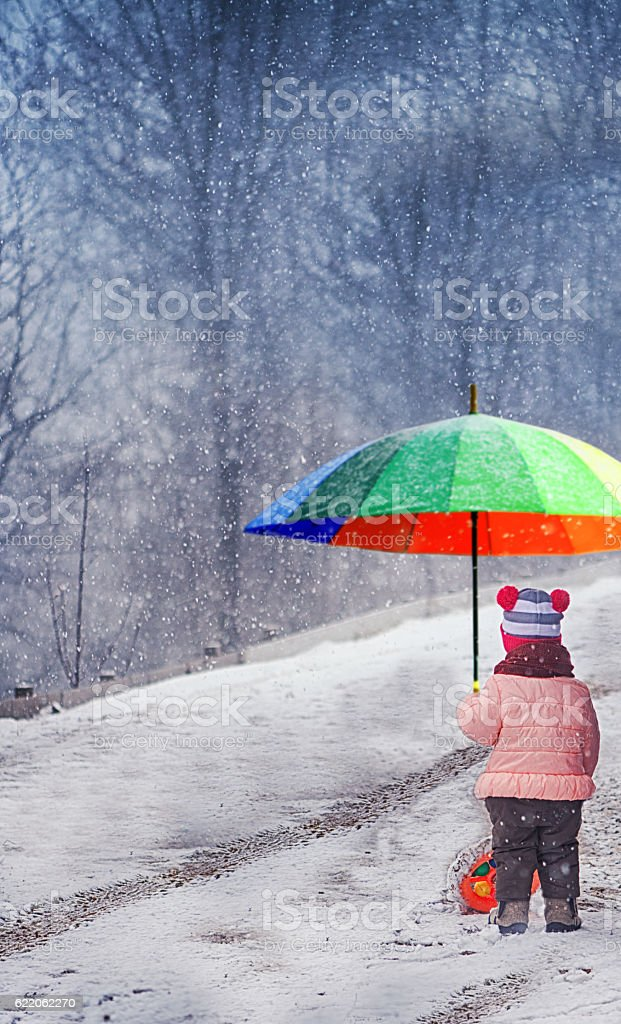 Little Girl With Umbrella in the Winter stock photo