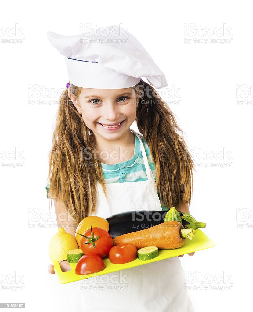 little girl with  vegetables stock photo