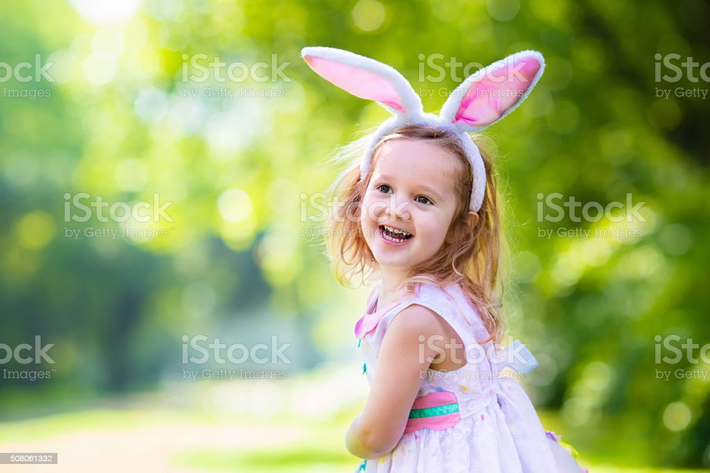 Little girl with white board for Easter greetings stock photo