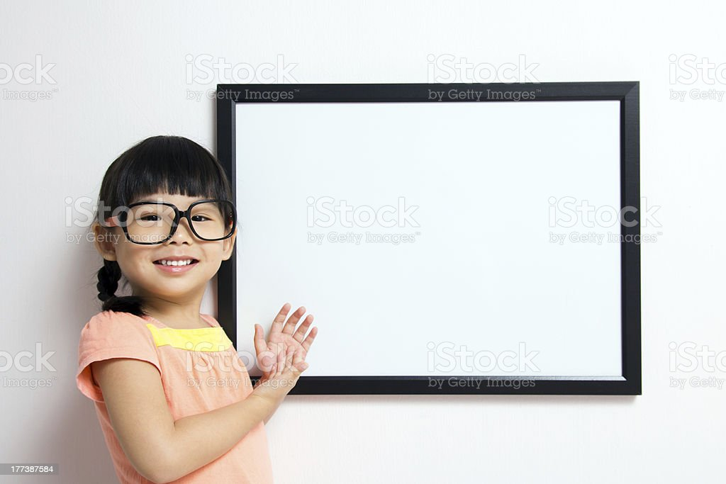 Little girl with white board royalty-free stock photo