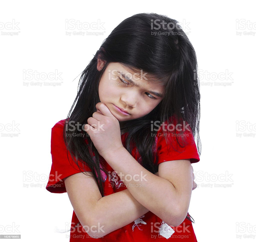 Little girl with worried expression stock photo