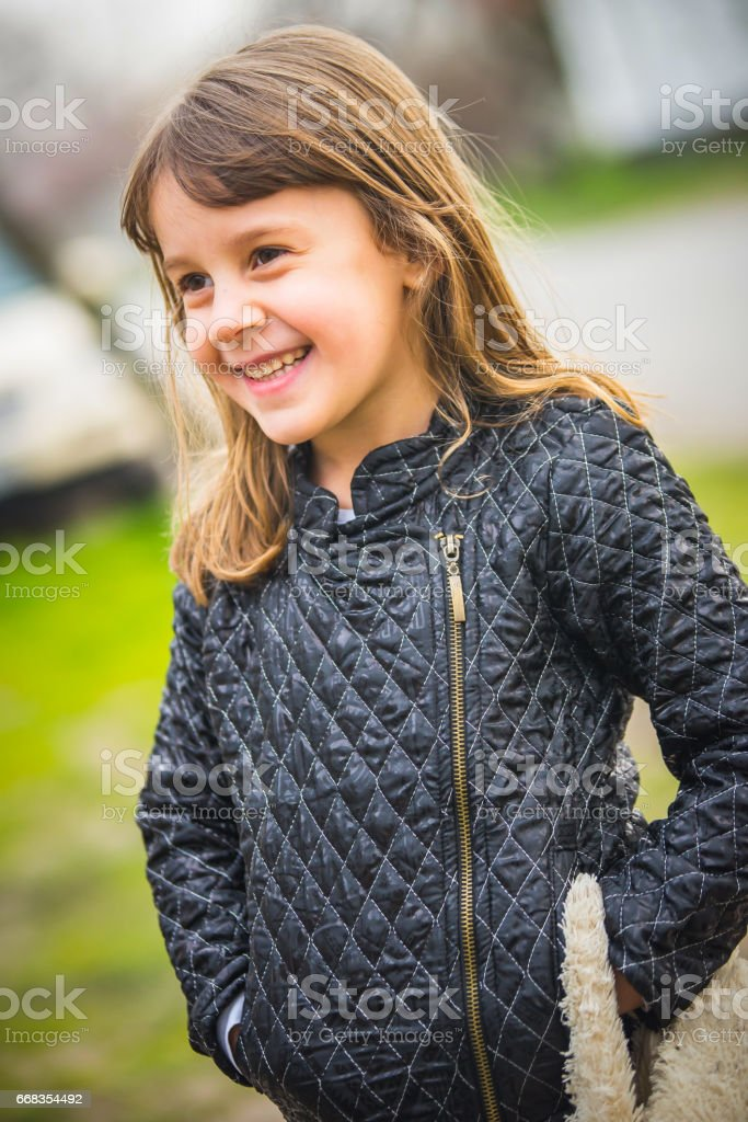 Little girl with your favorite toy stock photo