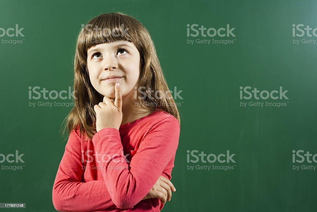 Little girl wondering royalty-free stock photo