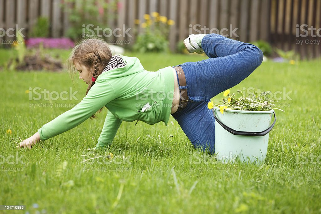 Little girl working in garden royalty-free stock photo