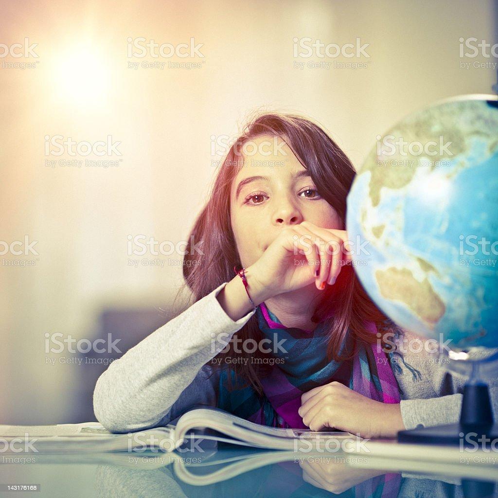 Little girl working on her homework royalty-free stock photo