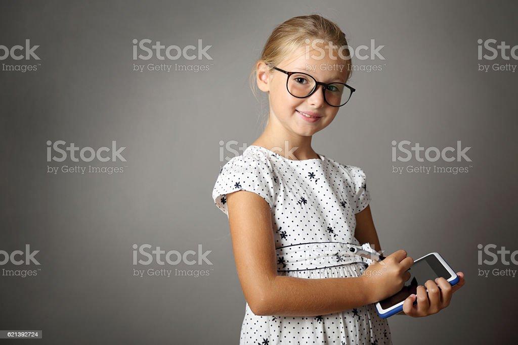 Little girl writes on the Tablet stock photo
