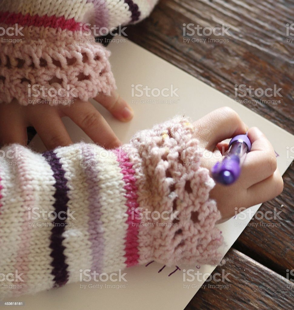 Little girl writing a note stock photo