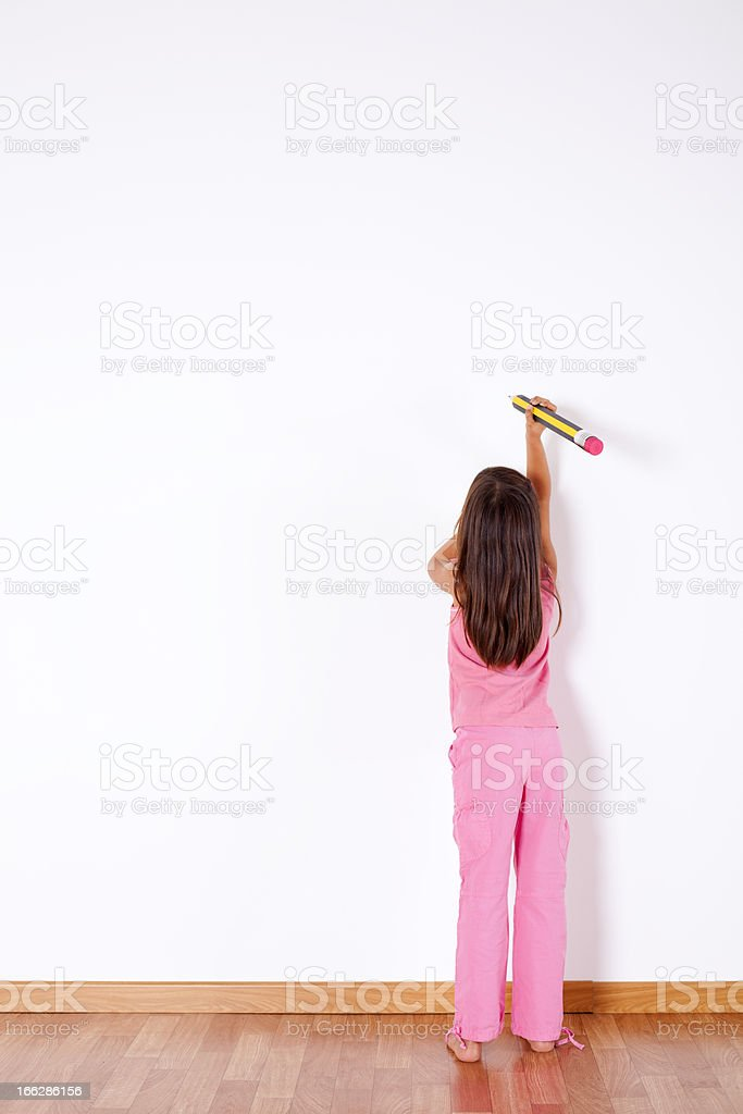 Little girl writing on the wall royalty-free stock photo