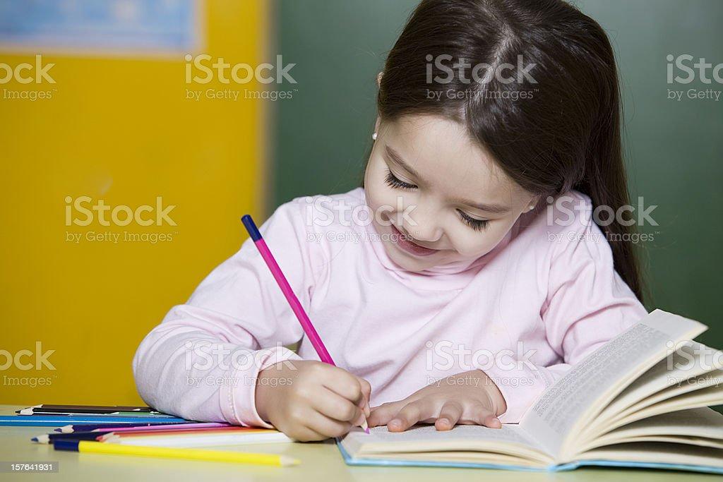 Little Girl Writing royalty-free stock photo