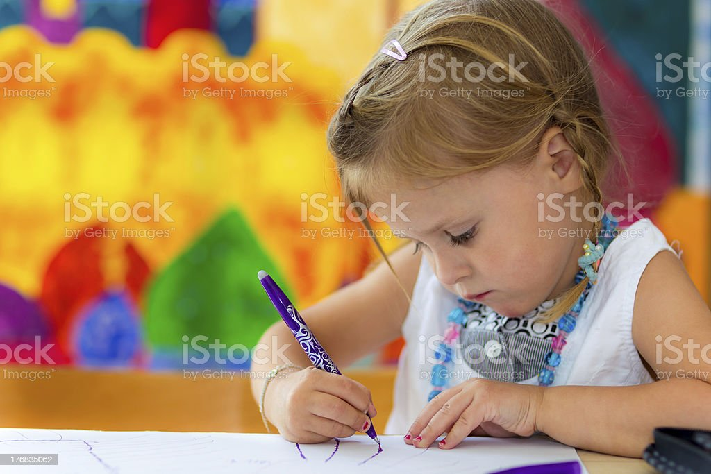 little girl writing stock photo