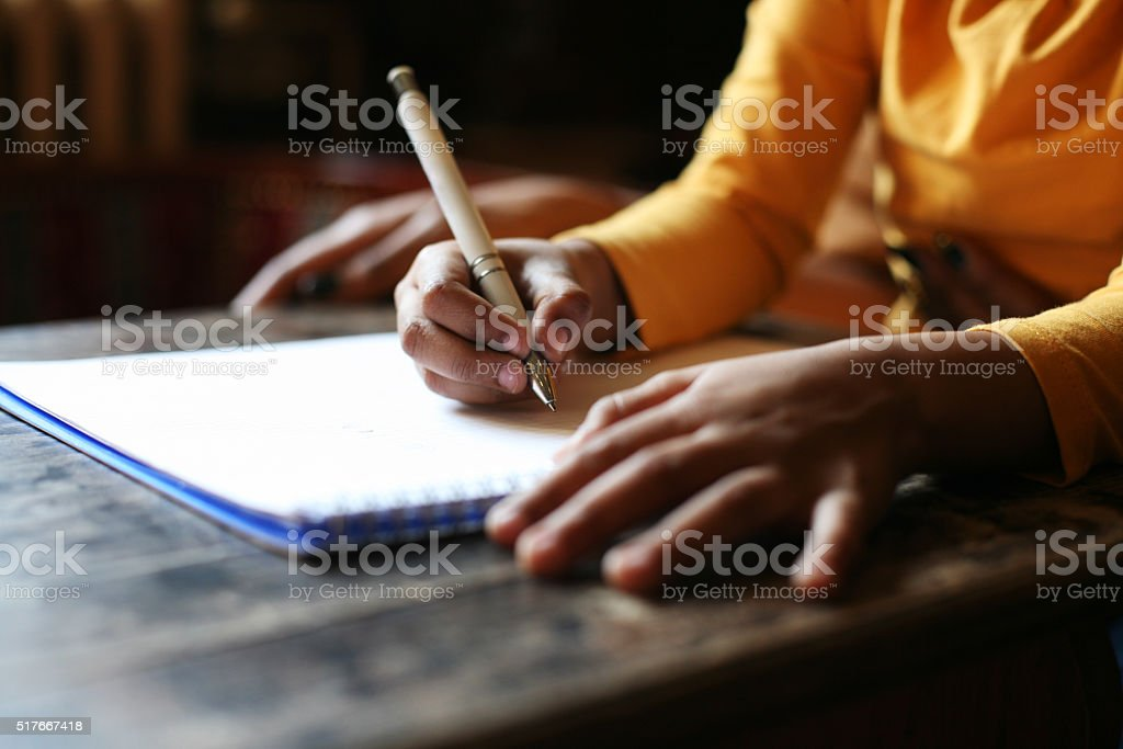 Little girl writting. stock photo