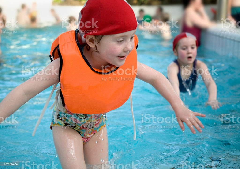Little girls at the swimming pool royalty-free stock photo