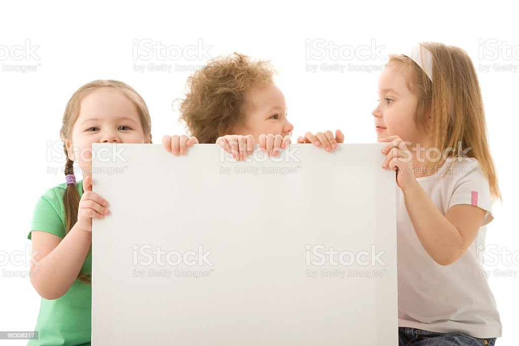 Little girls behind a blank board royalty-free stock photo