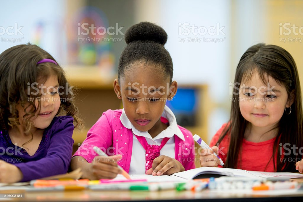 Little Girls Coloring Together stock photo