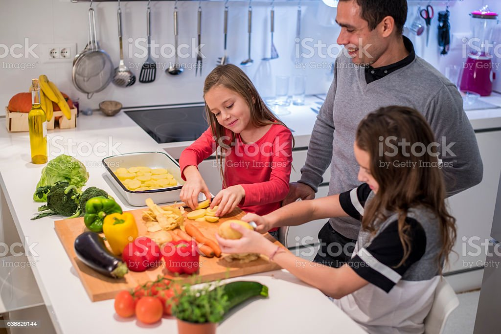 Little girls cooking stock photo