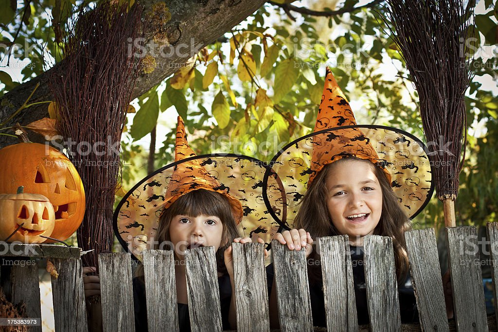 Little girls dressed up as witches for halloween royalty-free stock photo