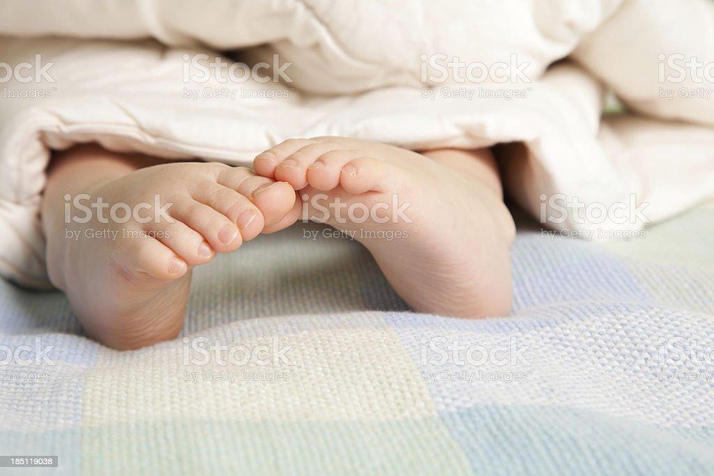 Little girl's feet stock photo