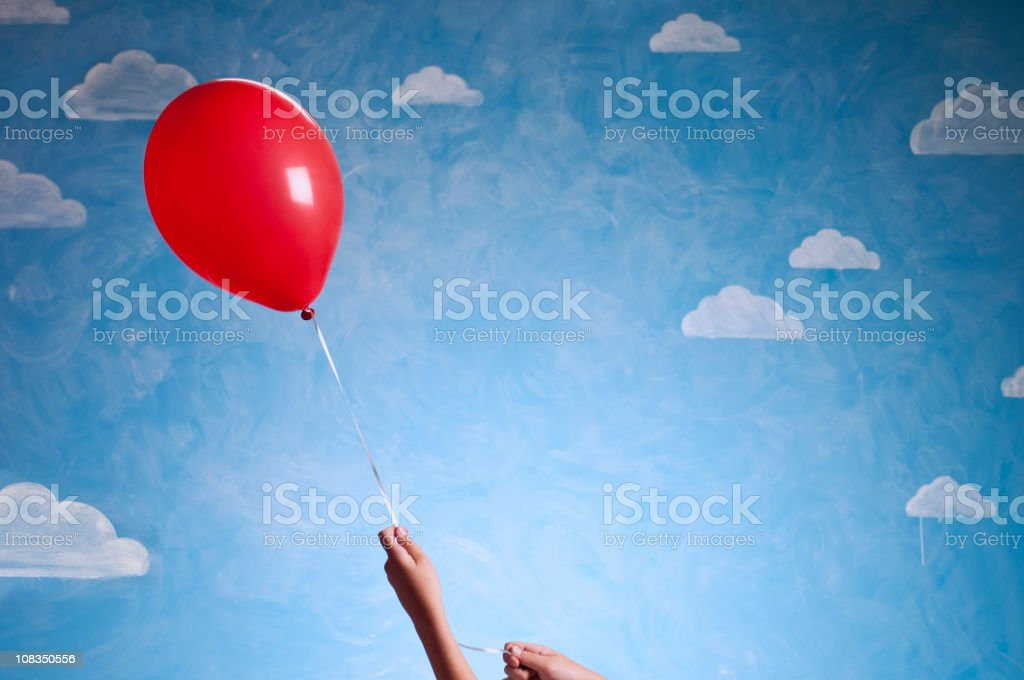 Little Girl's Hand With Red Baloon royalty-free stock photo