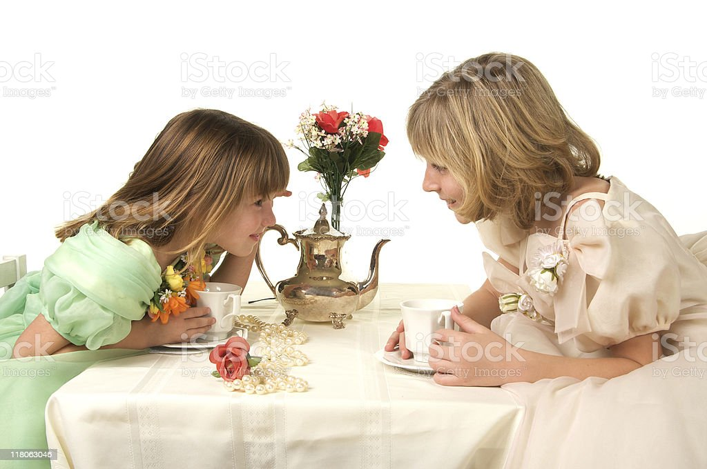 Little Girls Having a Fancy Tea Party on White Background royalty-free stock photo