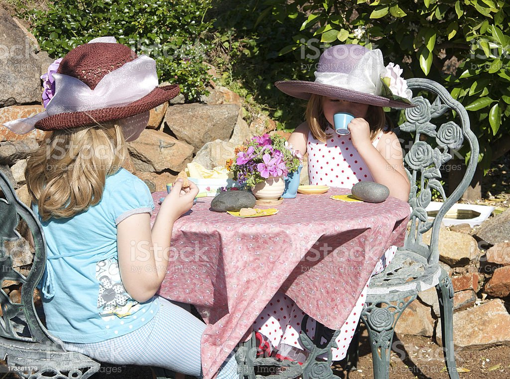 Little Girls Having a Fancy Tea Party Outdoors royalty-free stock photo