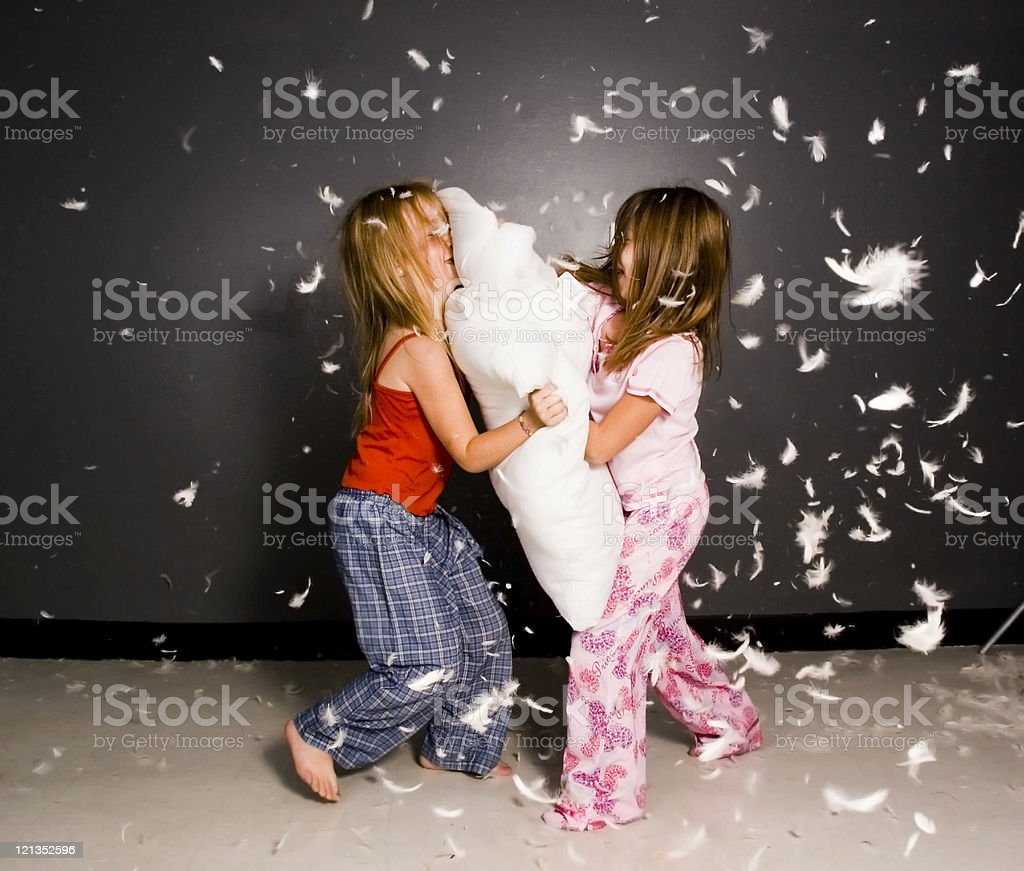 Little Girls Having a Pillow Fight! stock photo