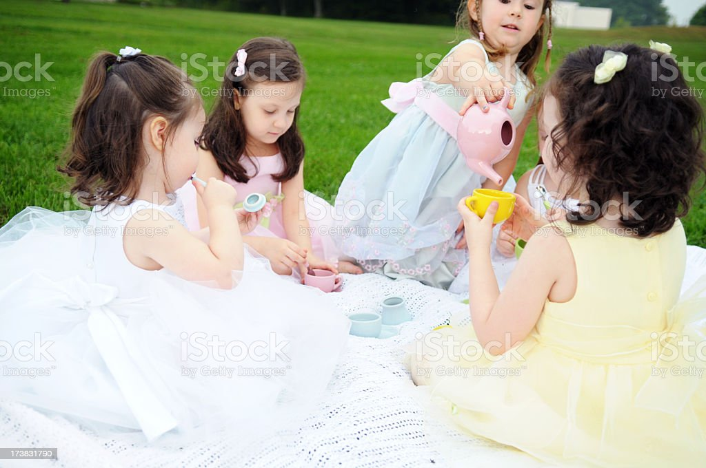 Little Girls Having an Outdoor Princess Tea Party royalty-free stock photo