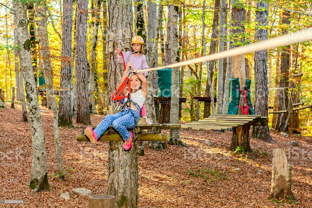 Little girls having fun in adventure park stock photo