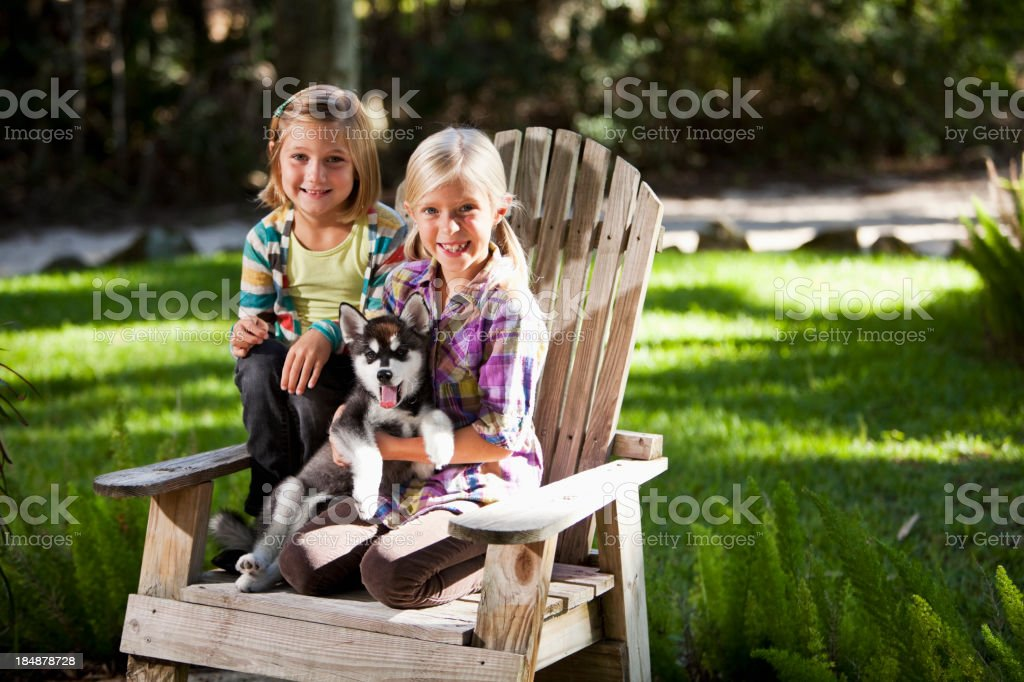 Little girls holding husky puppy royalty-free stock photo