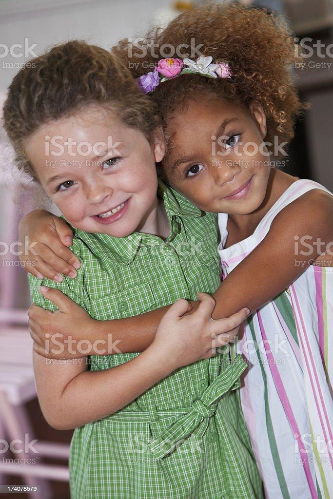 Little girls hugging stock photo