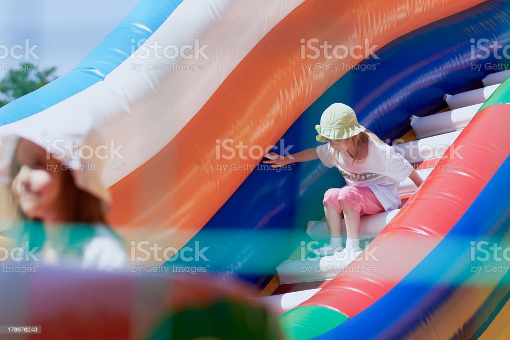 Little girls in a jumping castle stock photo