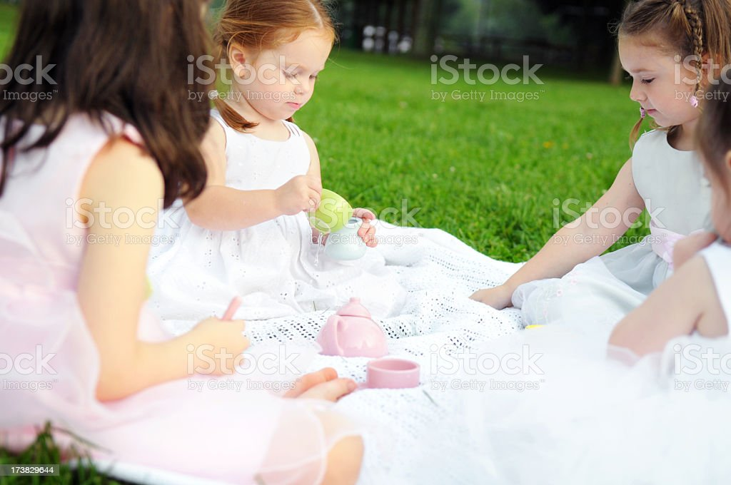 Little Girls in Dresses at an Outdoor Tea Party royalty-free stock photo