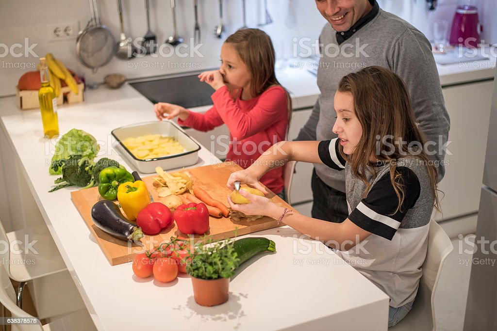 Little girls in the kitchen stock photo