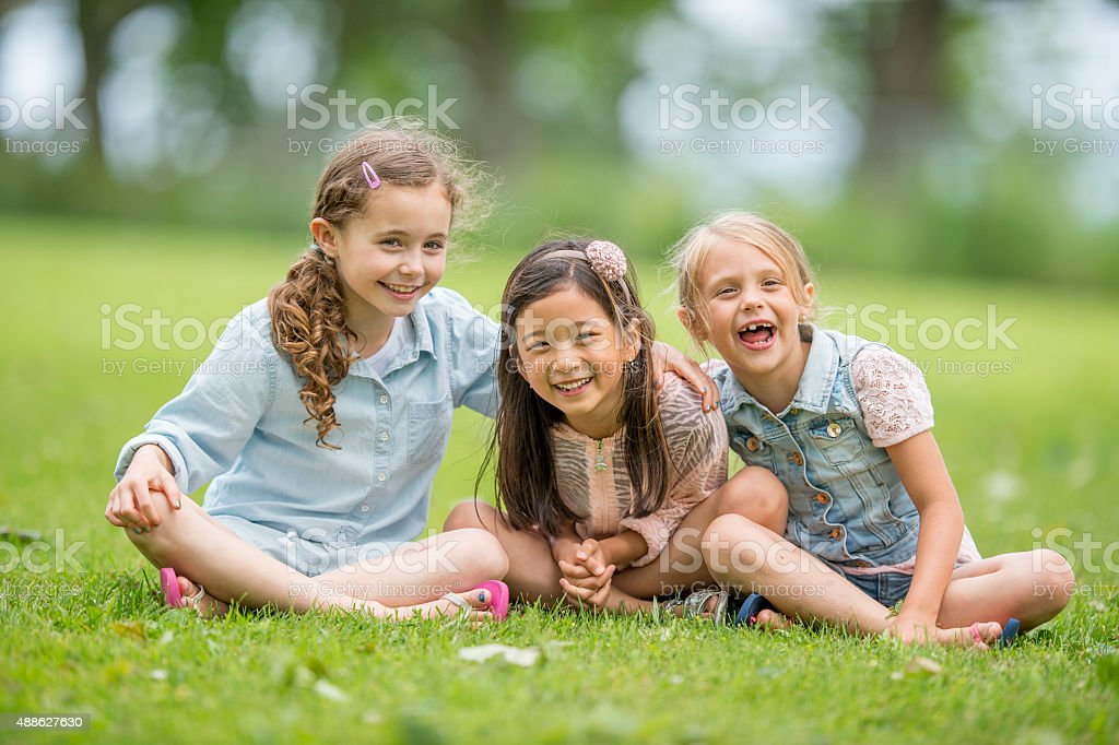 Little Girls Laughing Together stock photo
