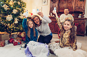 Little Girls Making Homemade Christmas Decorations