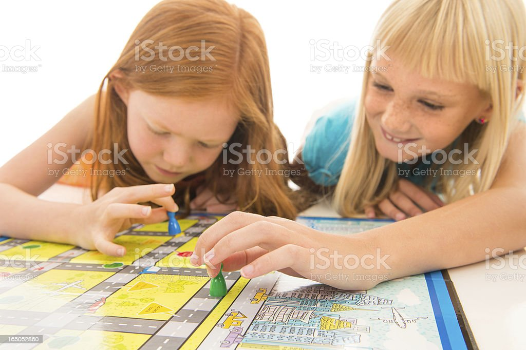 Little girls playing board game stock photo
