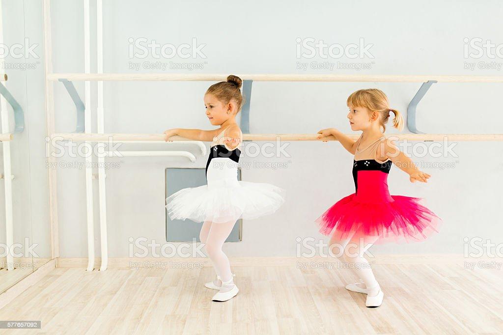 Little girls practicing ballet. stock photo